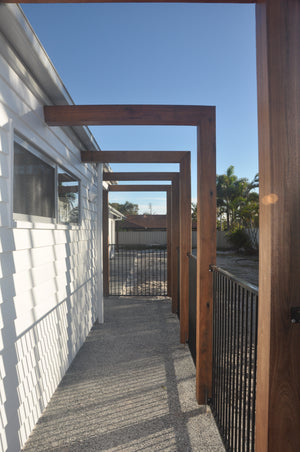 Stained timber posts and beams outdoor walkway