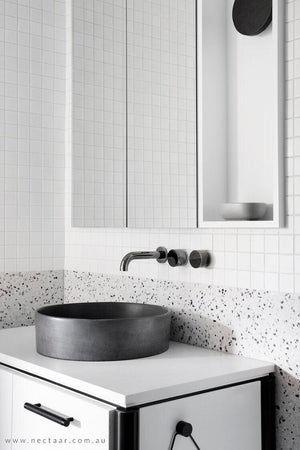 Dark charcoal halo basin on white vanity