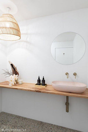Dusty pink Arc basin in white bathroom