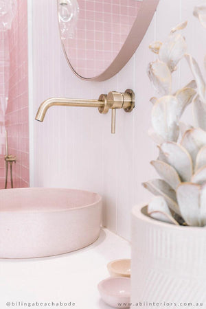 Pink halo basin with pastel coloured bathroom