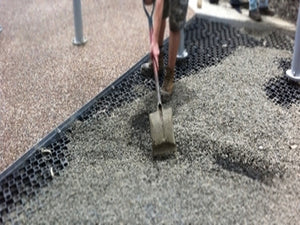 Landscaper using gravel cell to create a stable parking lot without the use of concrete