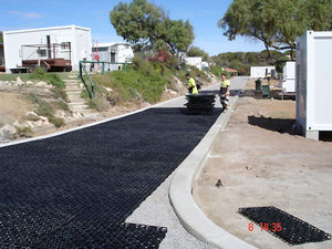Drainage cell laid prior to gravel being dropped