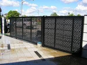 Commercial sliding gate using privacy screen panels