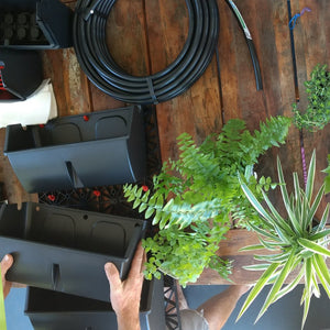 Customer about to start building her irrigated vertical garden