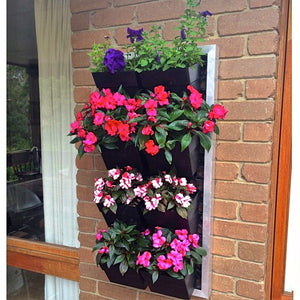 Green wall pots with flowers planted