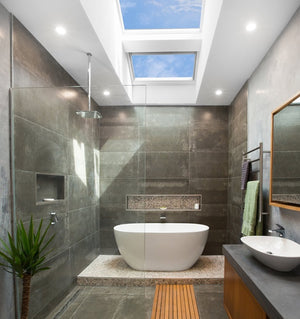 Bathroom featuring 2 velux solar skylights