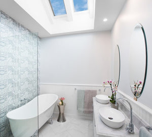 White bathroom with dual Velux skylights