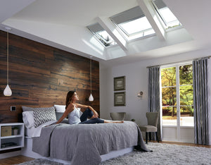 Bedroom featuring openable skylights and remote blinds