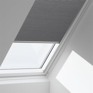 Manual honeycomb blind installed on pitched skylight