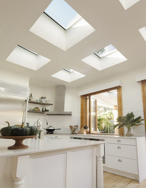Kitchen featuring velux flat roof skylights