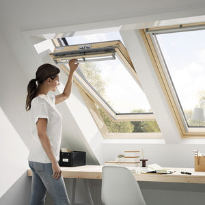 Velux Centre-pivot roof window with timber edging