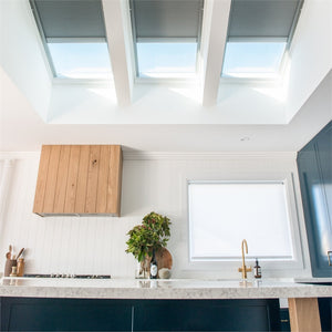 3 skylights with remote control blinds above vanity