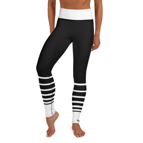Woman posing in custom high waist black and white striped yoga leggings