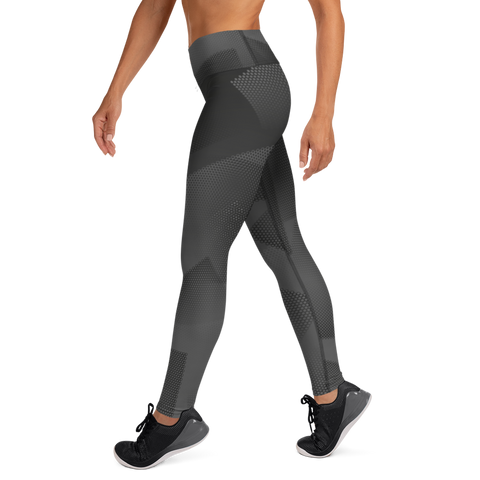 Woman posing in custom designed high waist black yoga leggings.