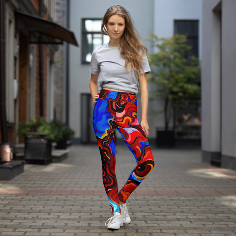 Woman posing in colorful custom high waisted yoga pants and crop top.