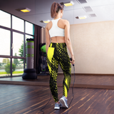 Woman jumping rope in custom print, high waist black and yellow yoga pants.