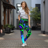 Woman posing in custom print high waisted yoga leggings and crop top.