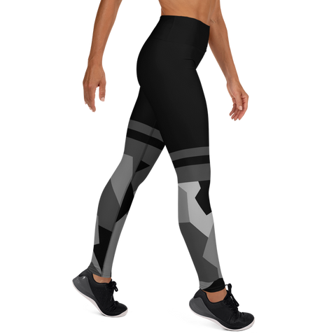 Woman posing in custom high waist black camo yoga leggings