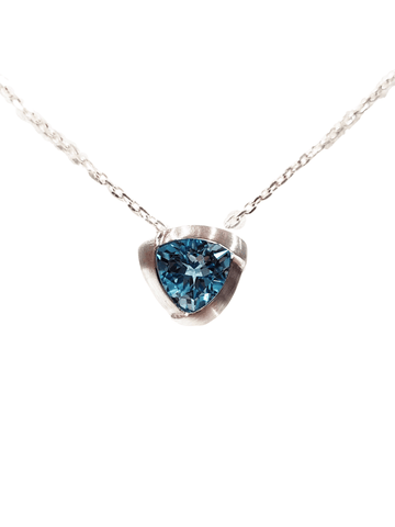 triangle shaped blue topaz sterling silver pendant with a silver chain made for Michael's Custom Jewelers in Provincetown