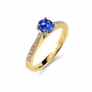 Vibrant Tanzanite and Diamond Ring in 18 carat gold