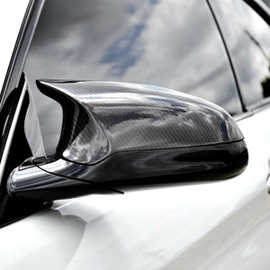 AutoTecknic Carbon Fiber Mirror Covers on a white BMW