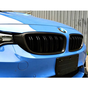 AutoTecknic Carbon Fiber Front Grilles on a blue BMW