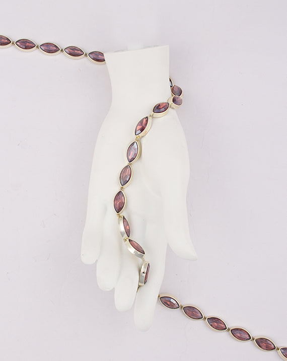 Water Gold Plated Leaf shaped Maroon stones Plastic base Chain