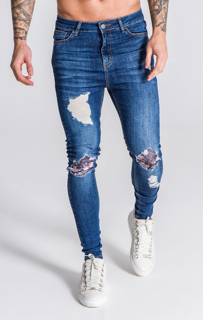 Blue Distressed Jeans With Nostalgic Roses Print Description