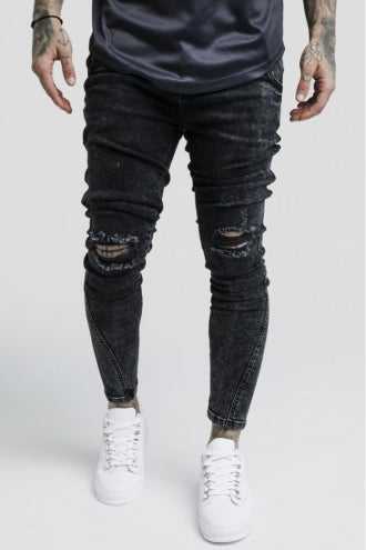 Knee Burst Twisted Skinny Denims - Washed Black