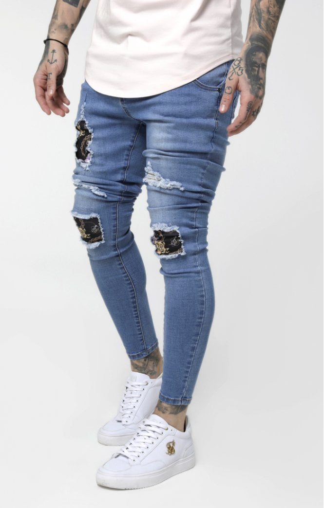 SikSilk Low Rise Distressed Burst Knee Denims - Light Midstone Blue - ZANMODA