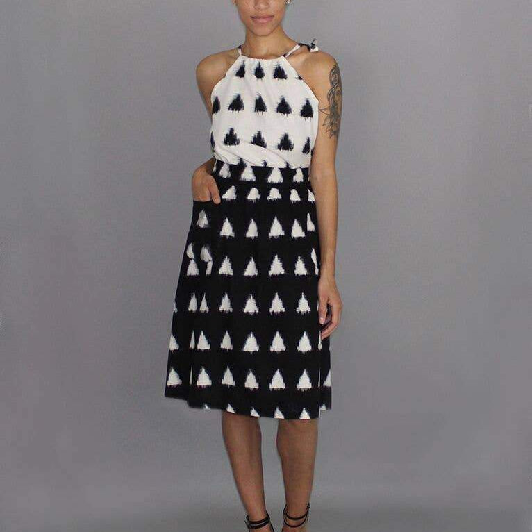 Black midi skirt with white triangle print on woman