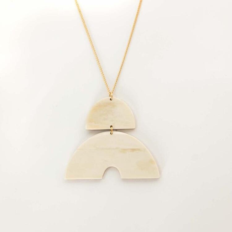 Bone arc pendant necklace molded by hand with ethically gathered cow bone in Haiti by Haiti Design Co