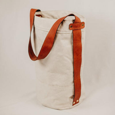 creme canvas bucket bag with brown leather strap