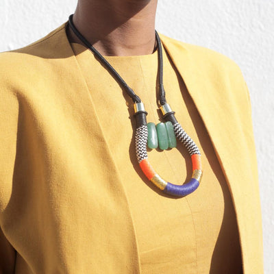 multi-colored pendant necklace on woman's neck