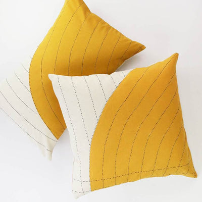 Two pillows with gold curve overlay pattern