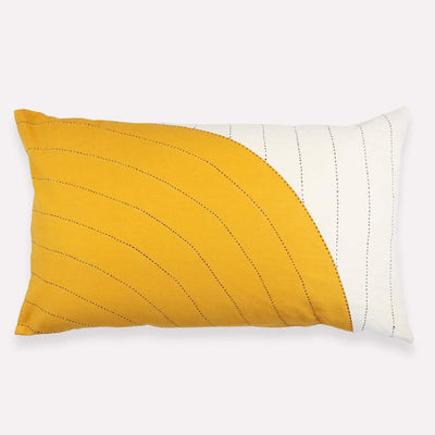 Pillow with gold curve overlay pattern