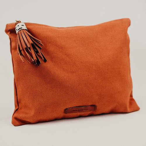 tan colored canvas pouch with leather tassel zipper