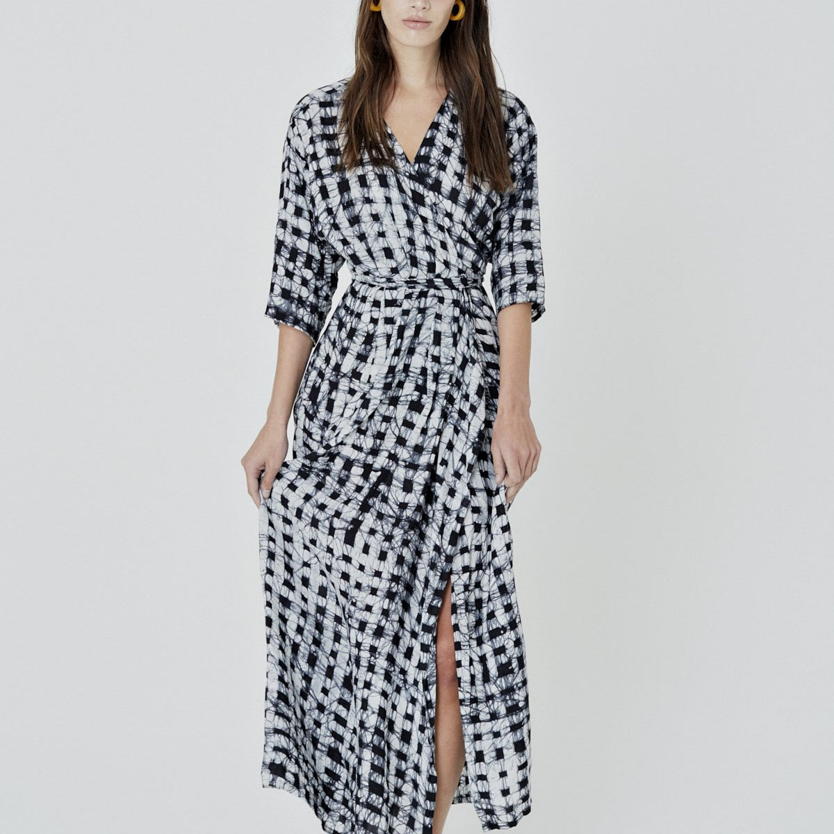 black and white checkered patterned wrap dress