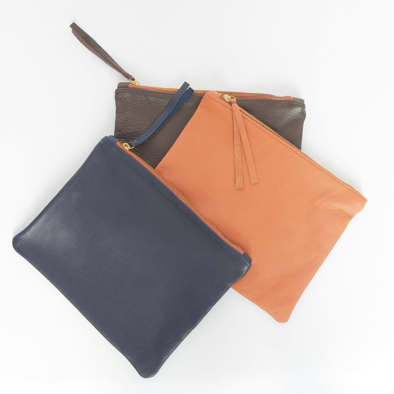 small leather pouches in tan, brown, and black