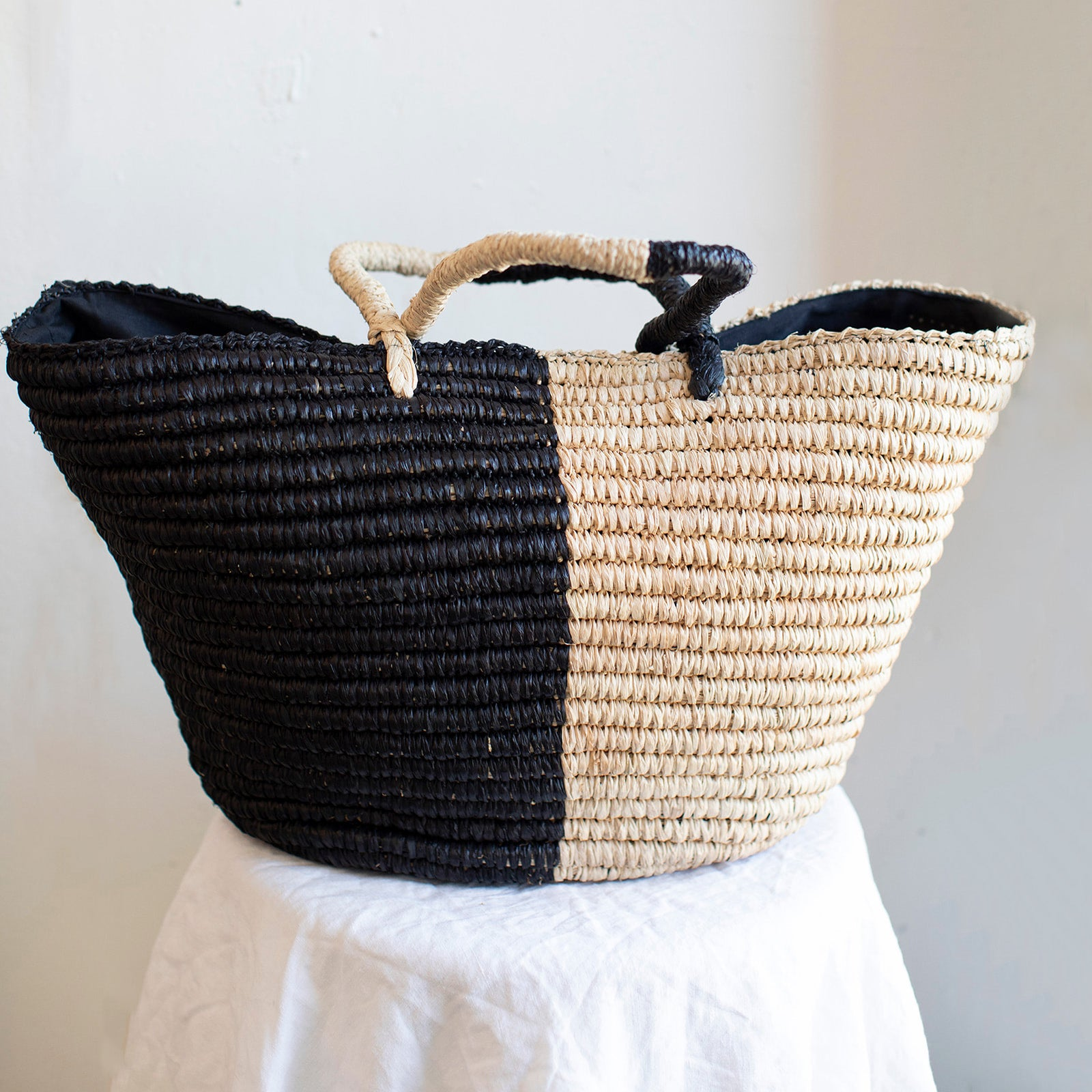 Large black and cream straw tote bag ethically made by Shebobo in Madagascar