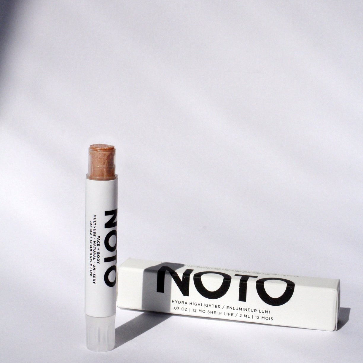 noto hydrater stick next to box container