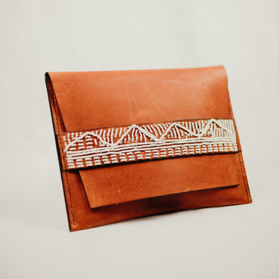 tan leather beaded clutch