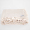 100% linen napkins in a natural tone with fringe details ethically made by Tonlé in Cambodia.