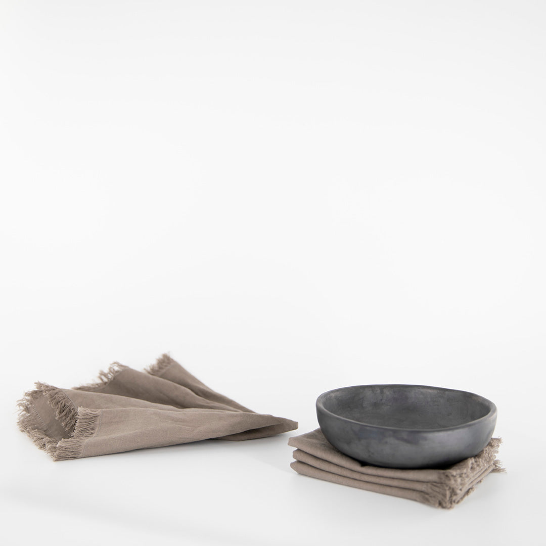 Styled set of 4 reusuable napkins in a slate color. 100% linen. Ethically made by Tonlé in Cambodia.