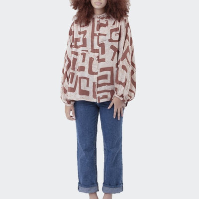 brown block patterned and white long sleeve button down shirt on woman