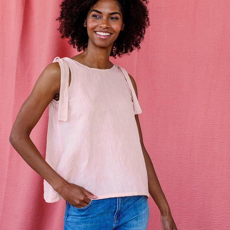 pink linen tank with adjustable shoulder ties on woman