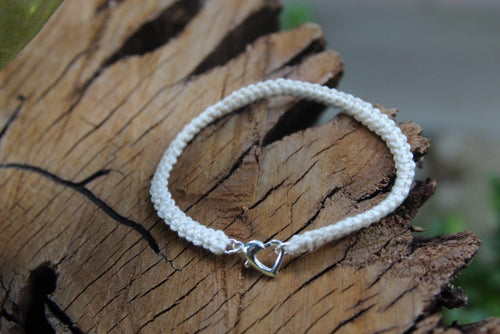 2nd anniversary cotton bracelet - cream with silver heart clasp