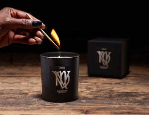 Illumine Virgo black candle on wood
