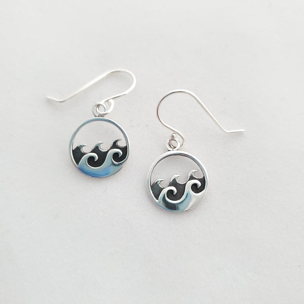 Sterling silver round earrings with multiple waves in center