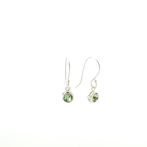 Green crystal August birthstone earrings shown on white background